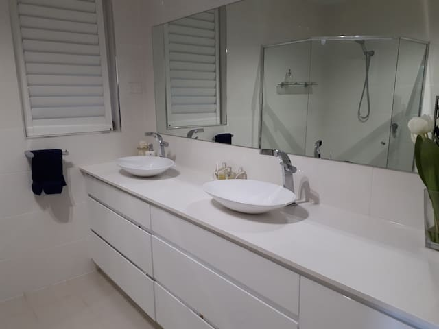There is a large private ensuite with  large shower, heated towell rail and overhead heat lamps.  Toiletries and extras are provided as  well as a hair dryer. An iron and board are available on request.