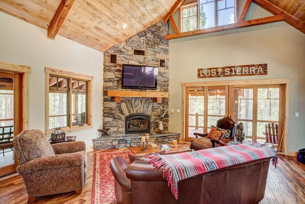 Gorgeous living room with stone fireplace