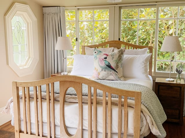In the Magnolia Room you will feel like your sleeping in the trees, the room offers a long double bed and all day sun.