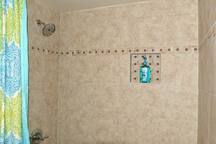 Shower and bathtub with tile and rain spray shower