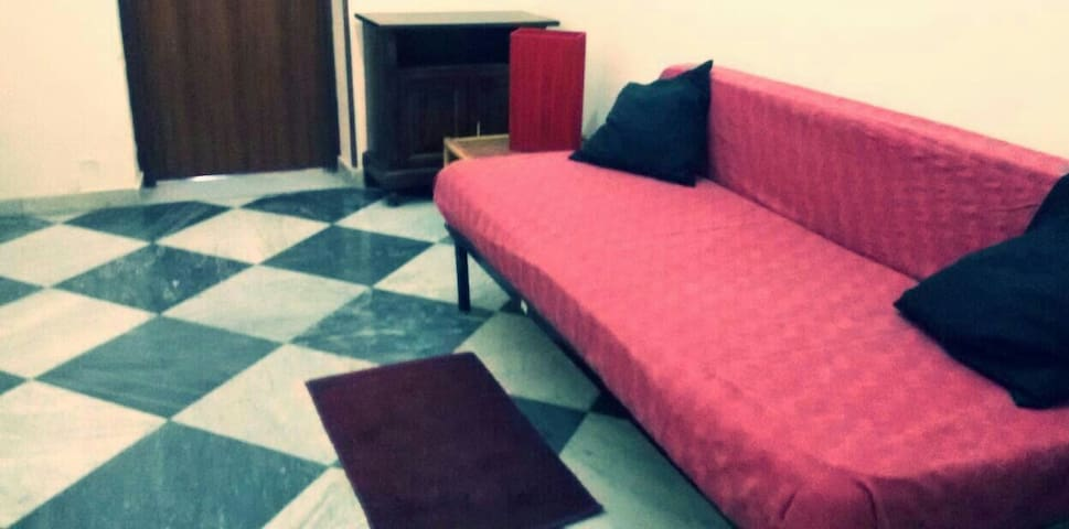 A bed in a young apartment