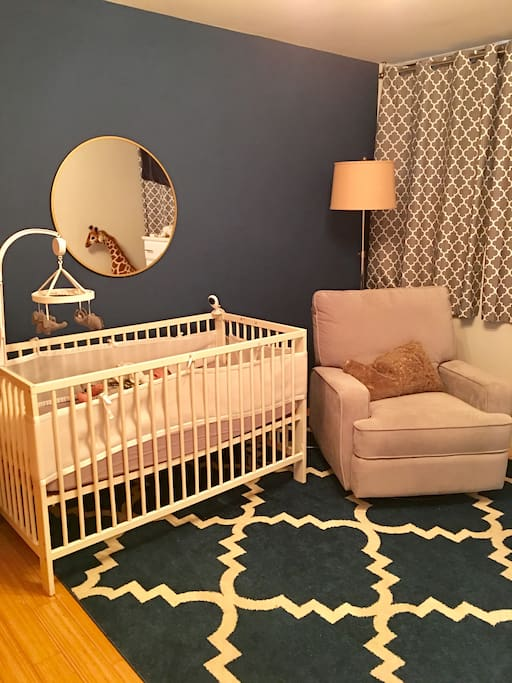 Kids room with crib and air mattress for adults if needed.