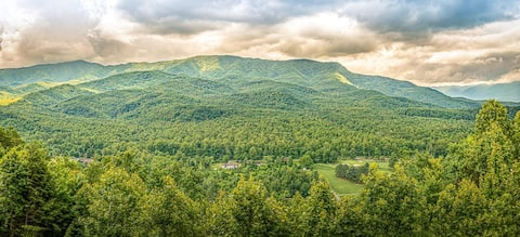 A gorgeous view of the mountains awaits you at this luxurious condo!