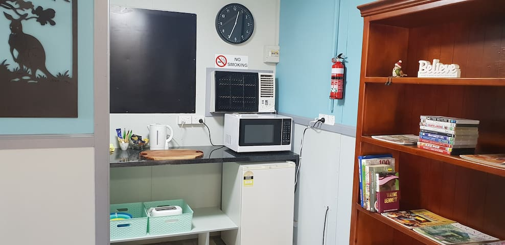 kitchenette; there is no stove but many types of cooking items which include a microwave, induction cooker plus spec pan and a rice cooker .The fridge is stocked with breakfast items for your self serve.