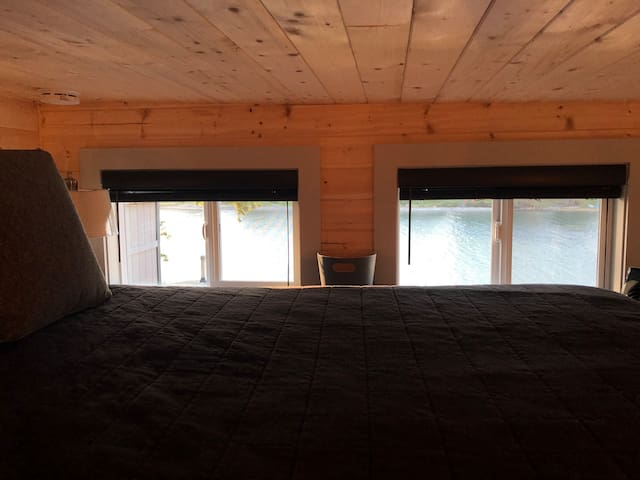 Master loft with queen bed & water view