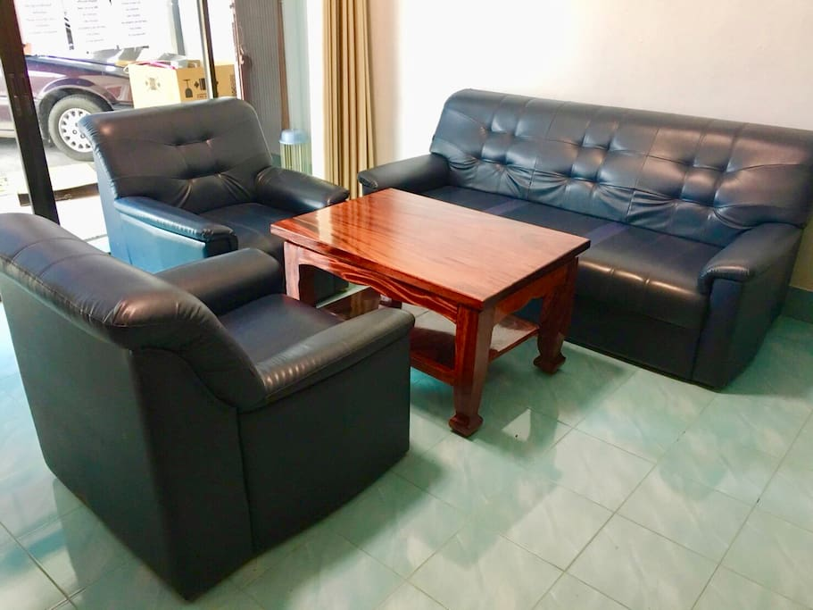 Sofas with wooden table in living room on front gate.