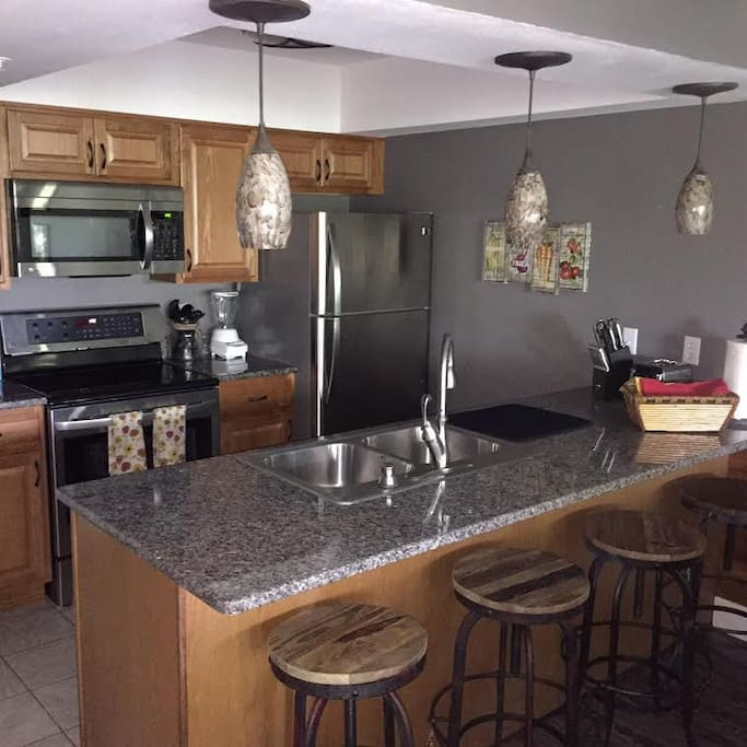 Kitchen with Granite Counters and Stainless Applia