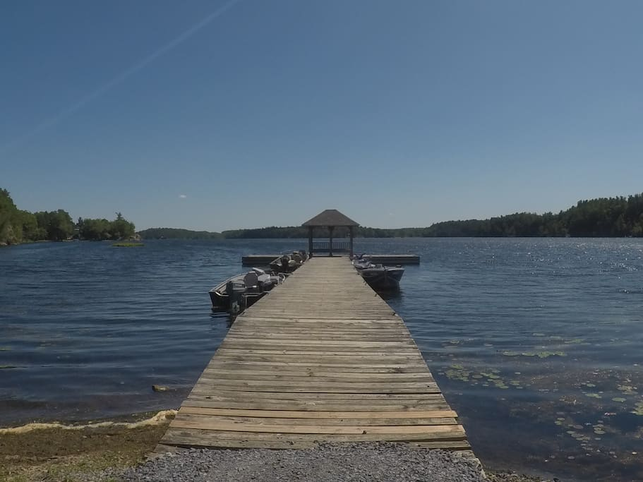 Public boat dock in front of cottage