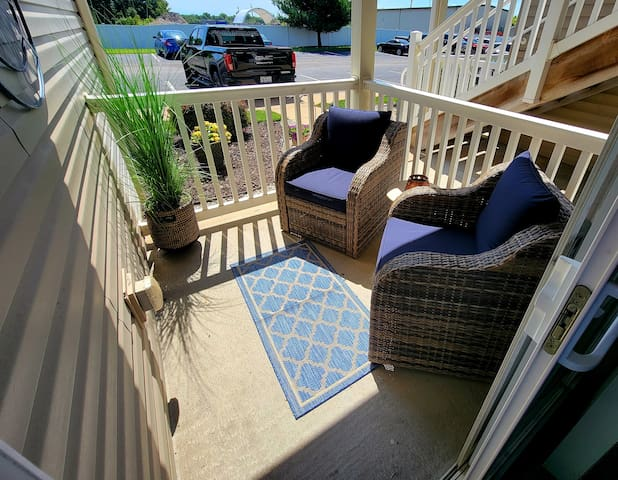 Enjoy your morning coffee or end your day with a glass of wine on our cozy patio in the comfortable chairs for two.