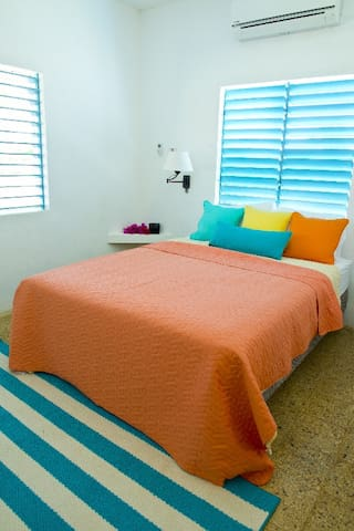 Bedroom with double bed. AC and screened windows.