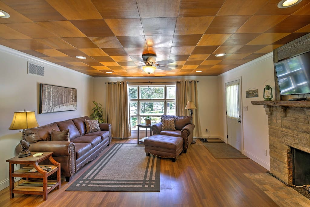You'll find hardwood floors and wooden ceilings throughout the home.