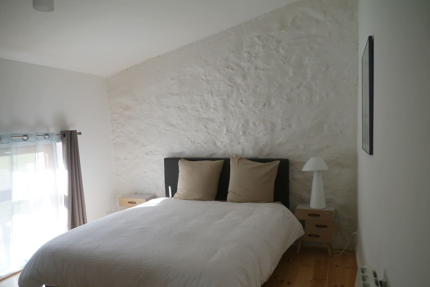 The spacious bedroom with ensuite bathroom, comes furnished with a kingsize bed and large wardrobe, (and radiator or fan dependant on season).  It overlooks the garden, field and mountains in the distance
