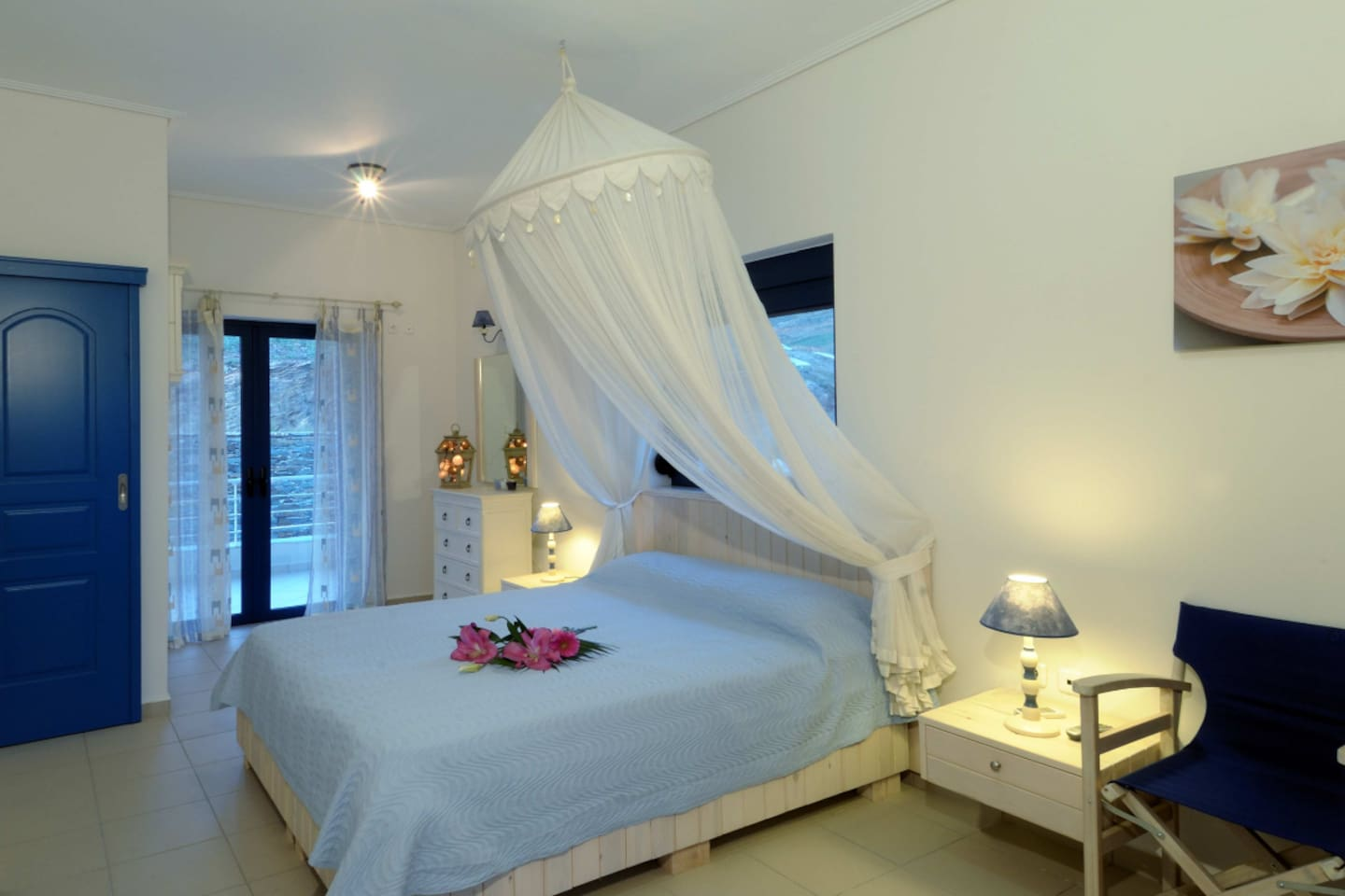 Our master bedroom. It has a double bed a balcony and a huge veranda. Sunny and airy will help you to relax and enjoy your vacation.