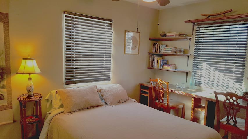 Your room has a new organic cotton queen size bed and a wall to wall counter top with 2 chairs.