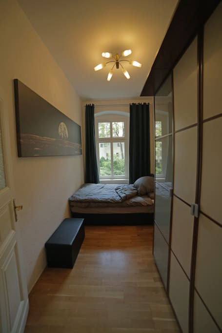 Your bedroom with comfy boxspringbed