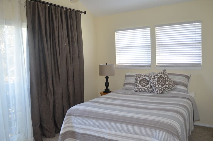 Master bedroom: new soft Plush carpeting and brand new Queen Bed