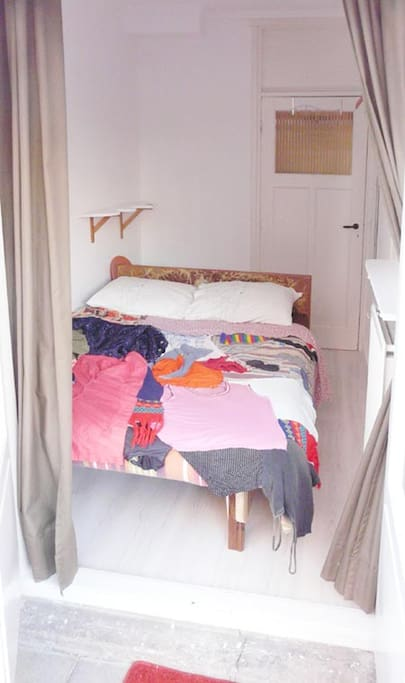 Double bed, here with an art-cover. We are artists and sculptors. So we built this bed. The mattress is 195 x 150 cm