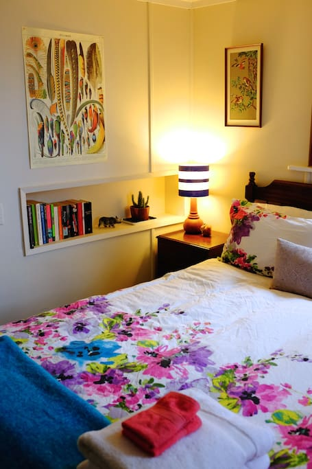 Warm, vibrant space with fresh linen, towels and a tiny library to peruse.