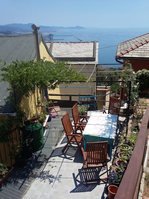 The yellow house overlooking Genova and it's sea