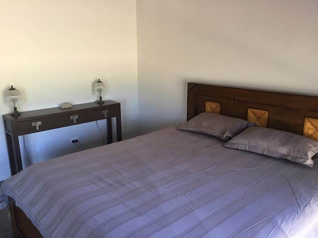 Modern comfort on acreage king bed 2