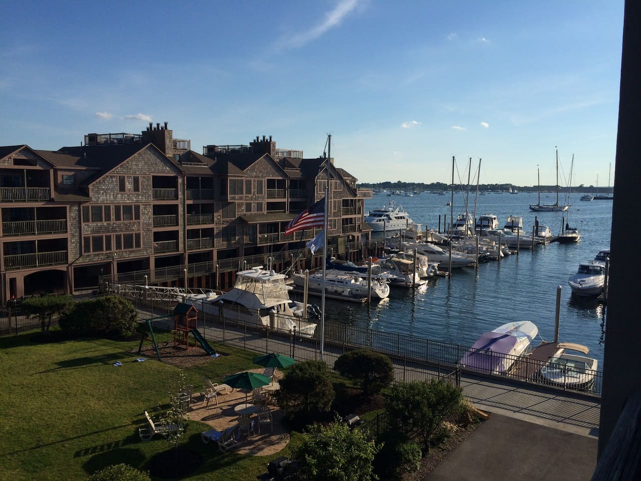 Harborside Resort with monster Yachts cruising by