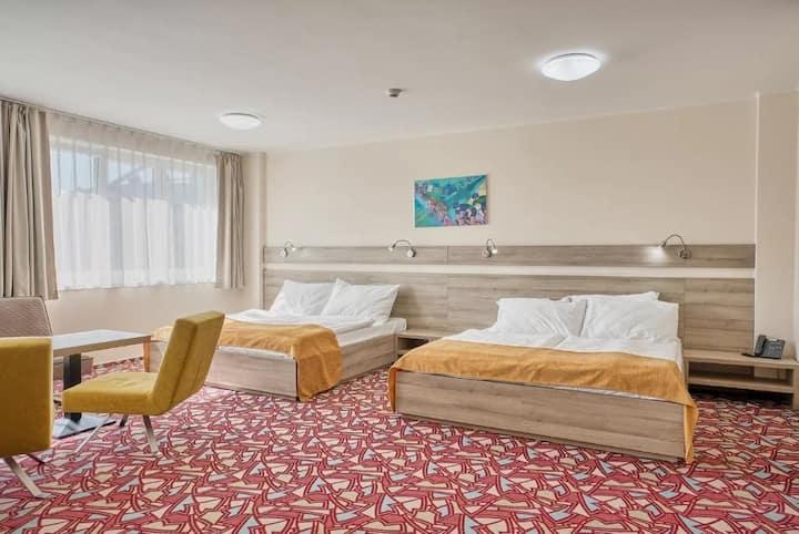 Deluxe pokoj se dvěmi manželskými postelemi