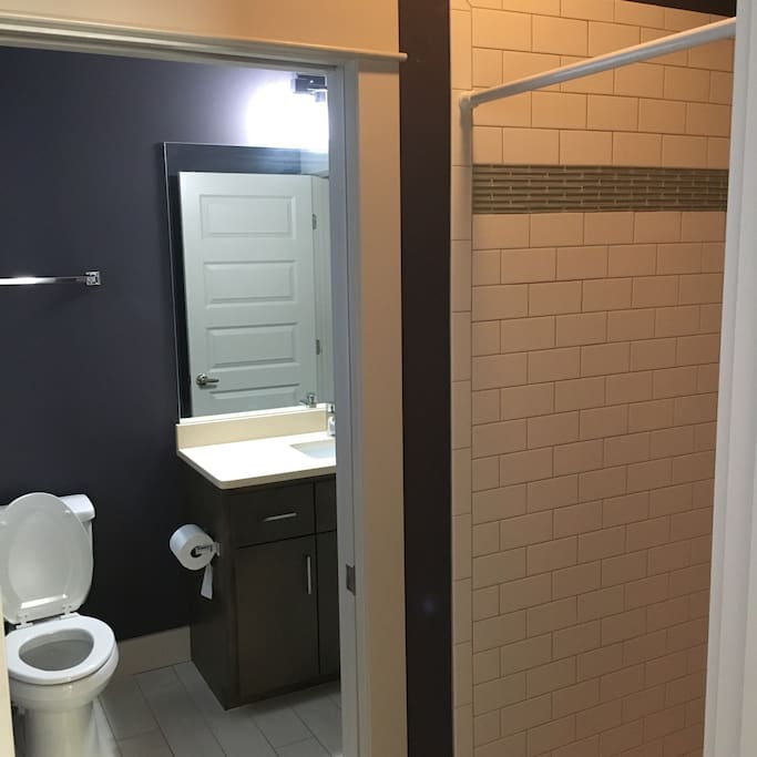 Self contained bathroom with gorgeous shower and sink.