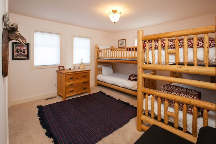Bunk room with two large bunk beds. Located downstairs off the family room and next to the bathroom pictured in the previous photo.