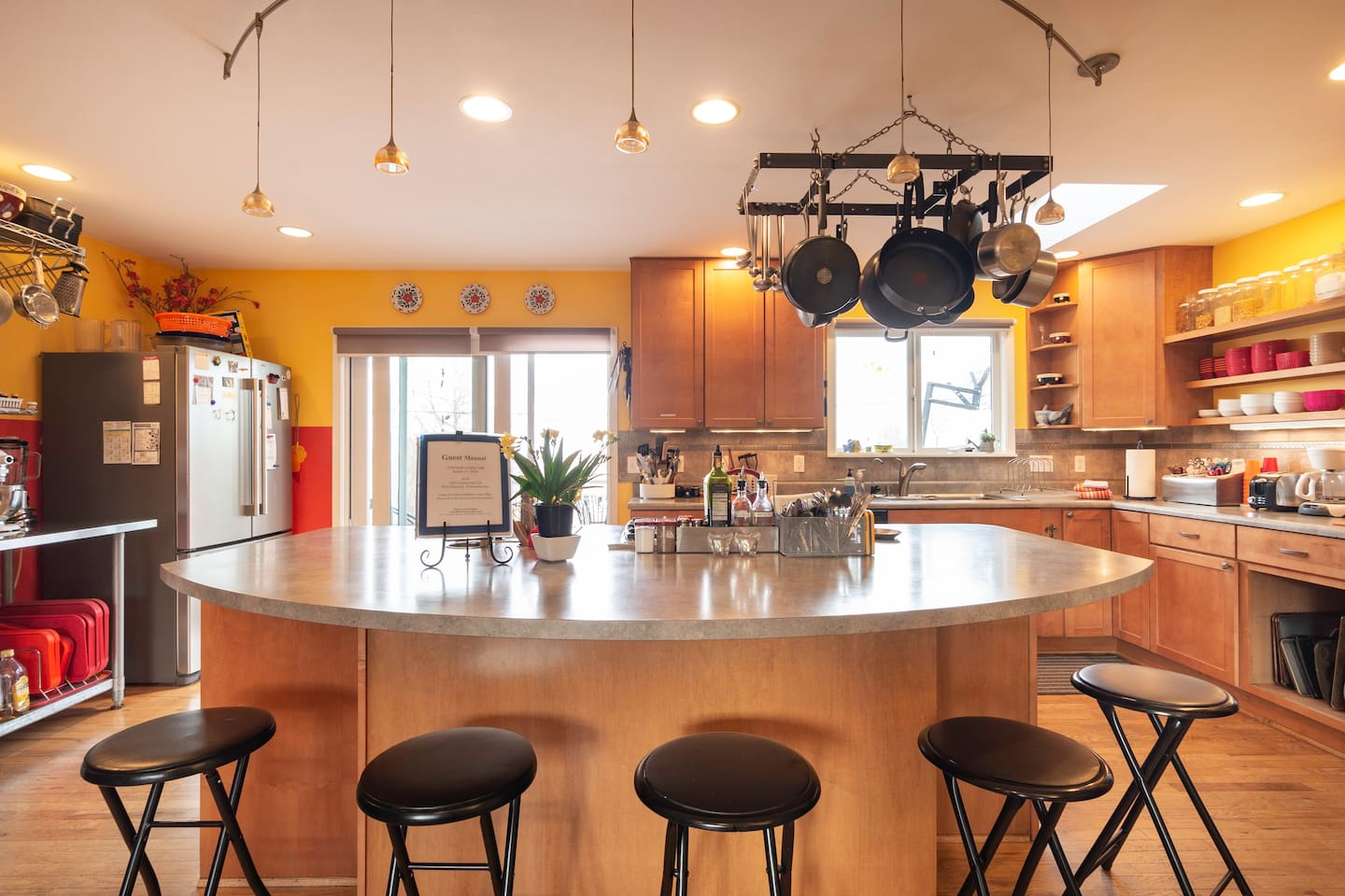 This coveted kitchen has an 8 ft counter, gas cooktop, wall oven & microwave. It is fully stocked and ready for you to cook like a chef or just hangout and enjoy the sunny view.