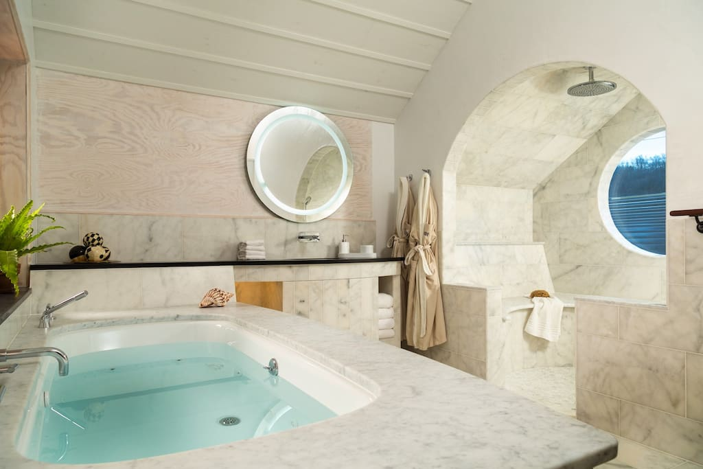 The ultimate in luxury. The Tree House at Bridgeton House with oversized 2 person Jacuzzi tub and marble rain shower with heated seats - both with river views.