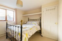 Bedroom 5 (11' x 11'). Large shelving and under-bed storage available. Room for additional mattress (provided) if required.
