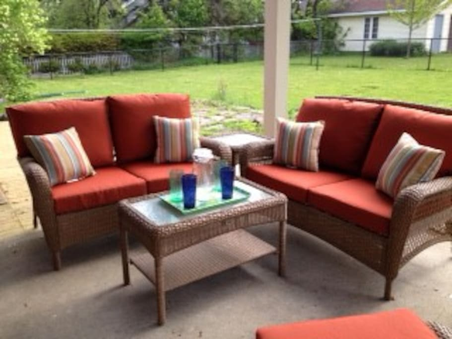 A covered back porch provides comfortable seating for six and room on an attached deck if you prefer the sun.