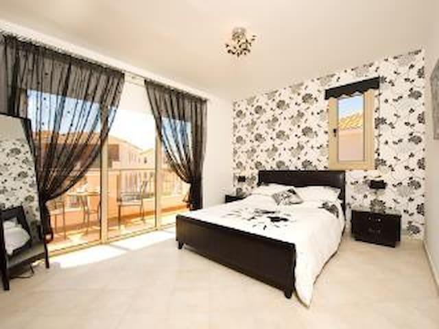 Stunning master bedroom with balcony