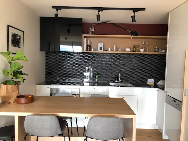 Equipped modern kitchen with a dining bar for meals or treats