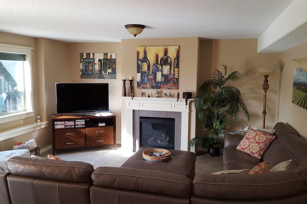 Living room area w/outdoor seating area in backdrop.