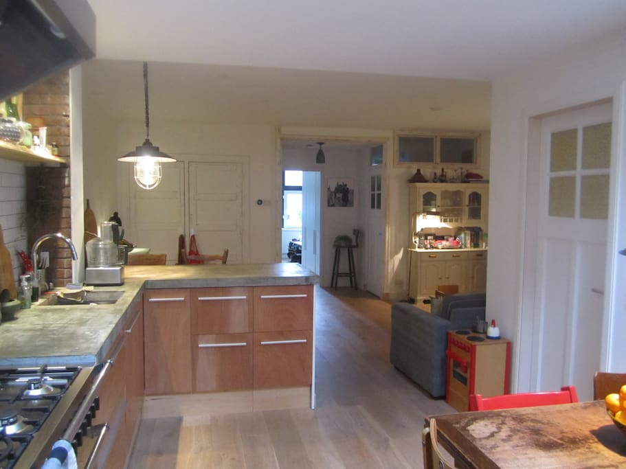 Big kitchen with table in it, view of the garden