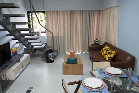 Furnished duplex apartment in high-rise building