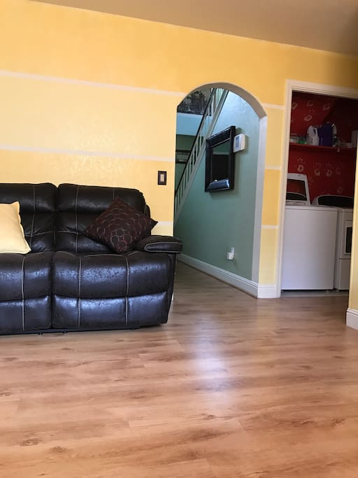 Shared living space...Sitting area, leading to living room, with laundry room. 1/2 bathroom downstairs .