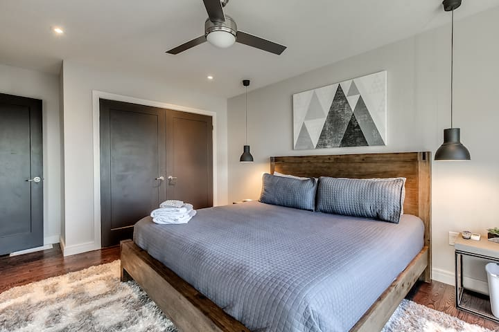 """Bedroom #1 (upper level) - View of lake/marina from King size bed, 42"""" TV, closet, balcony with chairs - perfect for a morning cup of coffee!"""