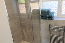 Roomy double shower with shampoo/conditioner and shower gel. Heated towel rail and fluffy towels.