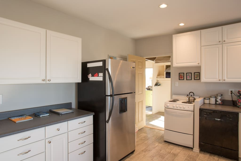 Modern appliances include filtered water and ice maker, toaster oven, cooking range and dishwasher and microwave. And a modern coffee maker with pods  for convenience.