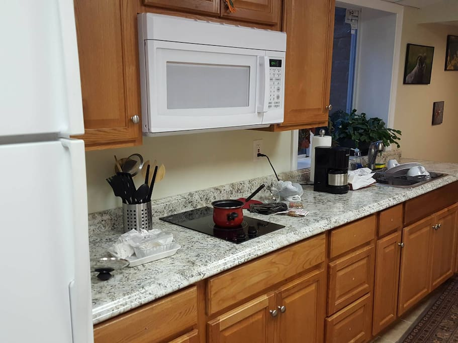 This is the guest kitchen equiped with large fridge, cooktop, microwave, toaster, coffee maker (shared with another tenant who is rarely home)