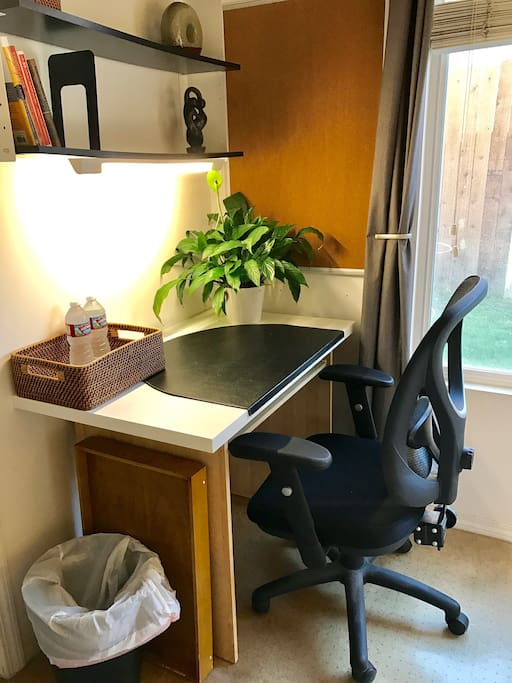 Comfortable, full-size work desk and chair.