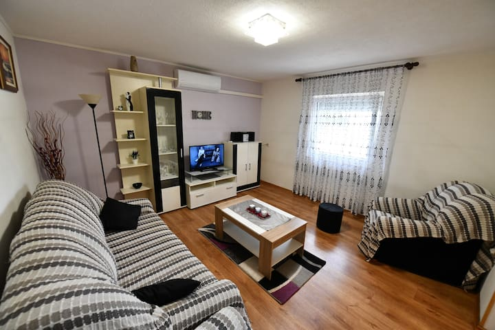 Spacious, air-conditioned living room area with sofa bed