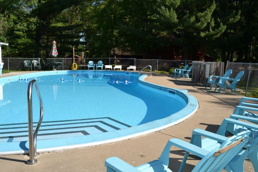 Outdoor pool on property
