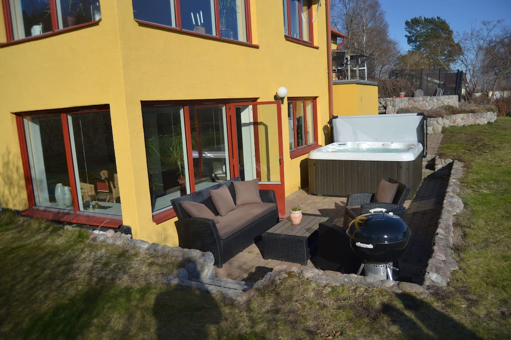 Privat patio with bbq, furniture and spa bath
