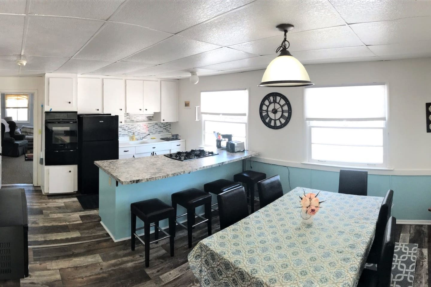 The Timeaway kitchen has a new built in oven, new stovetop, new refrigerator, countertop and backsplash.  There is lots of room to cook, play games or do a puzzle.  There is a window air conditioner for those humid days.  Lake Huron view!