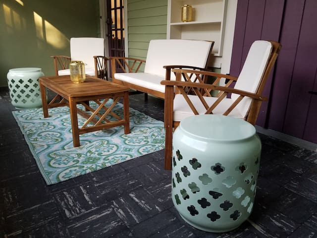 Inviting you to take in our quiet New Orleans neighborhood on the front screened porch