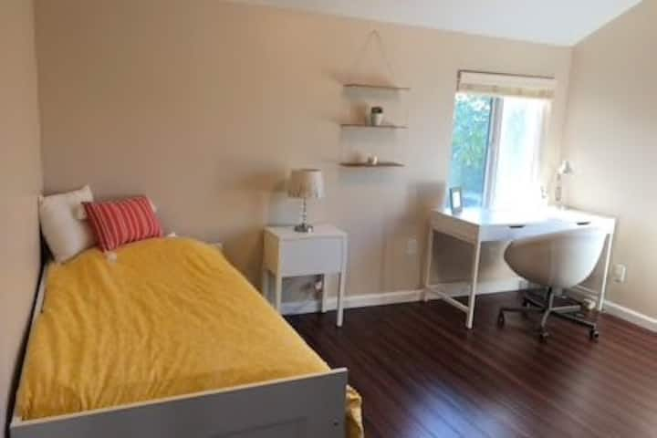 Bright yellow room in lovely south Davis house