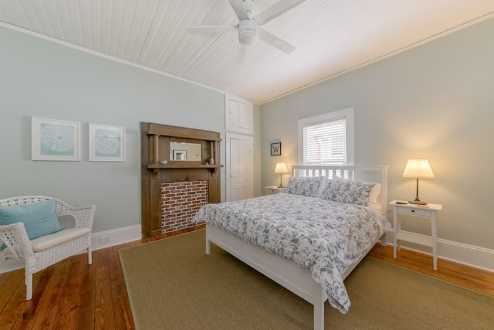 Beautiful master suite, with en suite bathroom, remote control ceiling fan, fluffy robes and full length mirror in closet.